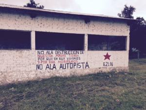 """No to the destruction of our Mother Earth, because we live in her and we will die for her. No to the super-highway,"" painted on a building in Los Llanos Ejido."