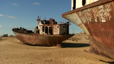 stock-footage-old-abandoned-ships-signify-the-ecological-disaster-that-is-the-aral-sea-in-uzbekistan