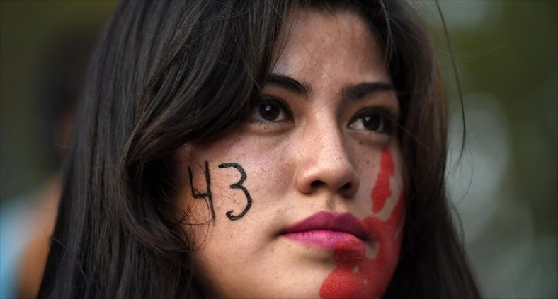 a-young-woman-takes-part-in-a-demonstration-demanding-information-on-the-whereabouts-of-the-43-missing-students-in-mexico-city-on-nov-5-2014-afp-800x430